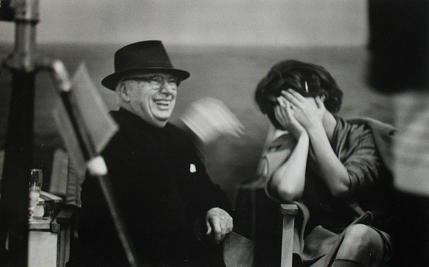 """Sophia Loren and Charles Chaplin on the set of """"A Countess from Hong Kong,"""" 1966 Pinewood Studios, Buckingham Shire vintage gelatin silver print Image Size: 9.5 x 14.5 inches   24.1 x 36.8 cm  Photograph by Hatami (1928-2017)"""