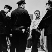 """Photograph by Hatami (1928-2017) Steve McQueen between takes with police extras, on the set of """"Bullitt"""" photograph 1968 vintage gelatin silver print, signed, stamped 11 x 9 inches"""