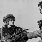 """Photograph by Hatami (1928-2017) Lara (Julie Christie) and Yuri (Omar Sharif), on the set of """"Doctor Zhivago"""" photograph 1965  vintage gelatin silver print, signed, stamped 9 x 11.5 inches"""