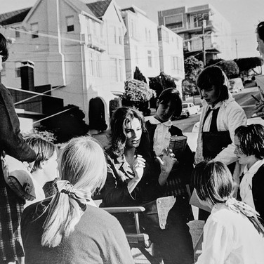 """Photograph by Hatami (1928-2017) Jacqueline Bissett talking to a group of schoolgirls, on the set of """"Bullitt"""" photograph 1968 vintage gelatin silver print, signed, stamped 8.5 x 11.75 inches"""
