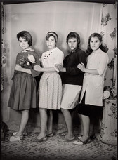 1960s black & white photograph of four women friends, posing in a photography studio