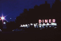 Film still from Roger Welch's video of a Diner changing over 24 hours