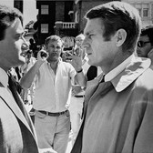 """Photograph by Hatami (1928-2017) Robert Vaughn, Steve McQueen and director Peter Yates setting up a shot, on the set of """"Bullitt"""" photograph 1968 vintage gelatin silver print, signed, stamped 8.25 x 11.5 inches"""