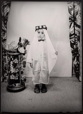 1960s black & white photograph of a child wearing ethnic middle-eastern garb in a photography studio