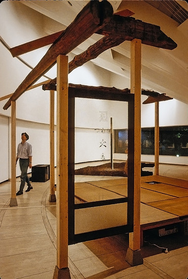 NOBUHO NAGASAWA My Home Sweet Home In Ruins (1992) scrap wood, tatami mat, earth, two monitors, 8mm film dimensions variable  Installation at the Setagaya Art Museum, Tokyo, Japan, 1992.