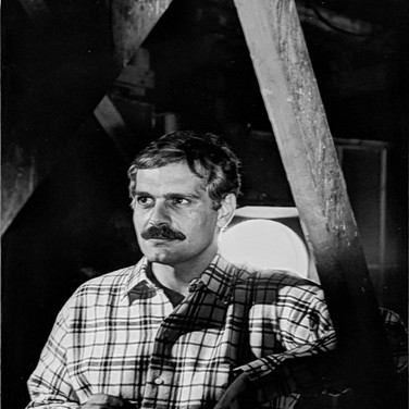 """Photograph by Hatami (1928-2017) Omar Sharif between takes on the set in Finland where parts of """"Doctor Zhivago"""" were filmed photograph 1965  vintage gelatin silver print, signed, stamped 11.5 x 7.5 inches"""