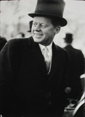 Black & white photograph of JFK in a top hat