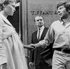 """Mia Farrow and Roman Polanski setting a scene in front of Tiffany, New York City, on the set of """"Rosemary's Baby"""" photograph 1968 vintage gelatin silver print, signed, stamped 8.2 x 10.75 inches Photograph by Hatami (1928-2017)"""