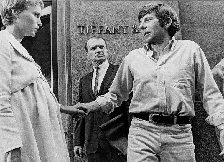 """Mia Farrow and Roman Polanski setting a scene in front of Tiffany, New York City, on the set of """"Rosemary's Baby,"""" 1968 vintage gelatin silver print, signed, stamped Image Size: 8.25 x 10.75 inches   21.0 x 27.3 cm  Photograph by Hatami (1928-2017)"""