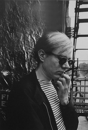 Bob Adelman (1930-2016)  Andy Warhol on the fire escape of the Factory on 47th Street photograph 1965 (printed later) unique, vintage gelatin silver print signed in ink, photographer's copyright stamps verso image size > 9.375 x 6.375 inches paper size > 11 x 14 inches