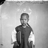 John Thomson (1837-1931)  Canton School Boy photograph  1868-1870 [printed later]  gelatin silver print from the glass negative, edition of 350  16 x 20 inches, stamped