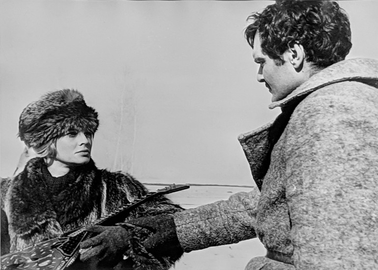 """Lara (Julie Christie) and Yuri (Omar Sharif) on the set of """"Doctor Zhivago,"""" 1965 vintage gelatin silver print, signed, stamped Image Size: 9 x 11.5 inches   22.9 x 29.2 cm  Photograph by Hatami (1928-2017)"""