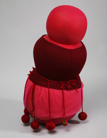 Red mixed-media sculpture of three round components stacked vertically, 2010
