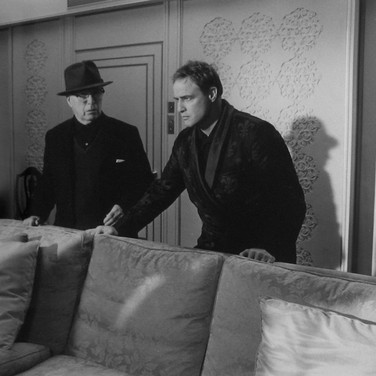 """Marlon Brando and Charlie Chaplin on the set of """"A Countess from Hong Kong,"""" 1966  Pinewood Studios, Buckinghamshire  vintage gelatin silver print image size > 9.5 x 14.5 inches  Photograph by Hatami (1928-2017)"""