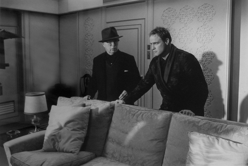 """Marlon Brando and Charles Chaplin on the set of """"A Countess from Hong Kong,"""" 1966 Pinewood Studios, Buckingham Shire vintage gelatin silver print Image Size: 9.5 x 14.5 inches   24.1 x 36.8 cm  Photograph by Hatami (1928-2017)"""