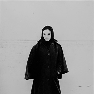 """Photograph by Hatami (1928-2017) Geraldine Chaplin preparing for a scene in the harsh tundra, in Russia, on the set of """"""""Doctor Zhivago"""" photograph 1965  vintage gelatin silver print, signed, stamped 9 x 6 inches"""