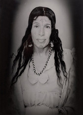 1960s black & white portrait of Amazigh woman with facial tattoos, wearing white dress, in a photography studio