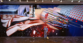 """BOB ADELMAN (1930-2016)  James Rosenquist in his studio in front of the mural, """"Star Thief""""  photograph 1981 (printed later)  archival pigment print, AP, signed  paper size > 30 x 15.75 inches"""