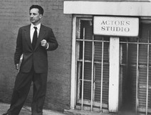Elia Kazan in front of the sign and barred windows of the Actors Studio in New York City, 1955