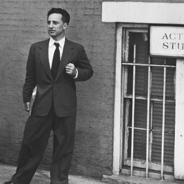 Roy Schatt [1909-2002]  Elia Kazan in front of The Actors Studio  photograph 1955  vintage gelatin silver print mounted on rag board, stamped  size > 9.75 x 12.5 inches