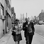 """Photograph by Hatami (1928-2017) Mia Farrow and Maurice Evans taking a break, walking in lower Manhattan, New York City, on the set of """"Rosemary's Baby"""" photograph 1968 vintage gelatin silver print, signed, stamped 10.75 x 7.8 inches"""