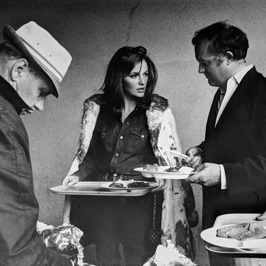 """Photograph by Hatami (1928-2017) Jacqueline Bissett and director Peter Yates during a lunch break, on the set of """"Bullitt"""" photograph 1968 vintage gelatin silver print, signed, stamped 8.25 x 11.25 inches"""