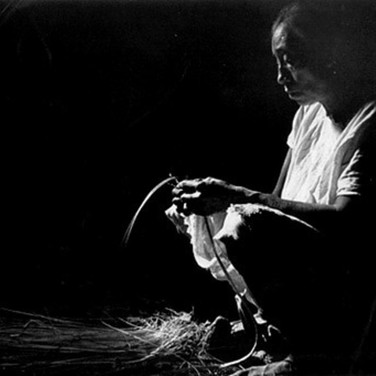 Leo Matiz (1917-1998)  Mayan Native Making Hats, Mexico, photo 1951 [printed later]  selenium toned gelatin silver print, edition of 30, stamped 16 x 12 inches