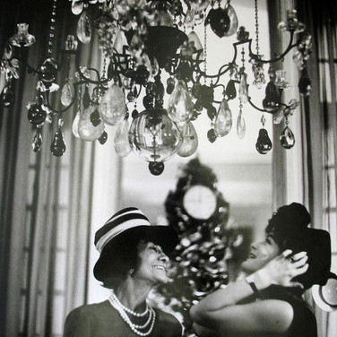 Coco Chanel and Romy Schneider, House of Chanel, Paris  photograph circa 1960s (printed later)  gelatin silver print, AP, signed  image size > 14.5 x 9.5 inches  Photograph by Hatami (1928-2017)