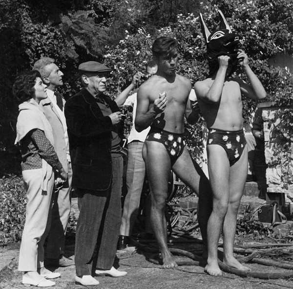 Lucien Clergue [1934-2014] Catherine Hutin-Blois, Jean Cocteau, Pablo Picasso and the dog men on the set of Testament of Orpheus, Les Baux de Provence photo 1959 [printed 1985] gelatin silver print, edition of 30 MF, signed Paper Size: 17.5 x 15.5 inches | 44.5 x 39.4 cm Image Size: 14 x 14 inches | 35.6 x 35.6 cm