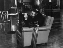 James Dean smokes in leather lounge chair at the ABC Studios in New York City