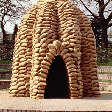 "Nobuho Nagasawa Phalz Kapelle (Phalz Chapel), 1994 sandbags, barbed wire, hourglass, water 14 x 13 x 13 feet  From ""Invisible Nature,"" Ludwig Museum für Internationale Kunst, Aachen, Germany, 1994"
