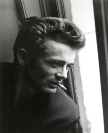 James Dean poses while smoking and staring out the window at ABC Studios in New York City