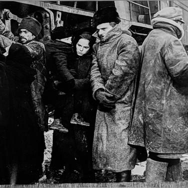 """Geraldine Chaplin and Omar Sharif in a scene where they are leaving Moscow for Varykino, on the set of """"Doctor Zhivago"""" photograph 1965  vintage gelatin silver print, signed, stamped  9 x 11.5 inches Photograph by Hatami (1928-2017)"""