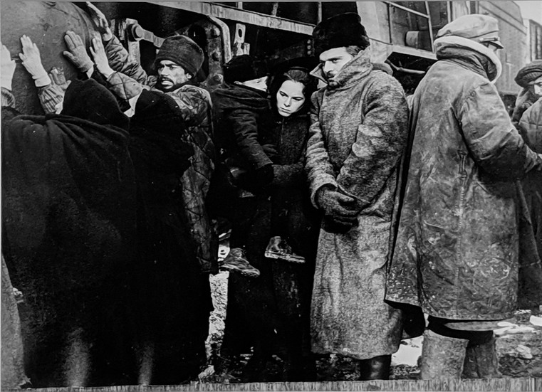 """Geraldine Chaplin and Omar Sharif in a scene where they are leaving Moscow for Varykino, on the set of """"Doctor Zhivago,"""" 1965 vintage gelatin silver print, signed, stamped Image Size: 9 x 11.5 inches   22.9 x 29.2 cm  Photograph by Hatami (1928-2017)"""
