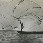 Leo Matiz (1917-1998) Fisherman, Magdalena, Colombia photo 1939 [printed later] selenium toned gelatin silver print, edition of 30, signed, stamped 11 x 14 inches