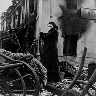 """Photograph by Hatami (1928-2017) Geraldine Chaplin in a scene depicting the Soviet Union, on the set of """"Doctor Zhivago"""" photograph 1965 vintage gelatin silver print, signed, stamped 9 x 11.5 inches"""