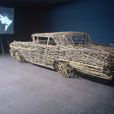 Roger Welch Drive-In: Second Feature, 1982 twigs, tree branches (willow, maple, spruce, pine), bamboo, twine and adhesive to bind knots, 16 mm film with continuous projection system car size: 60 x 72 x 216 inches Collection of the Guggenheim Museum, New York  First exhibited at the Whitney Museum of American Art, New York, 1982