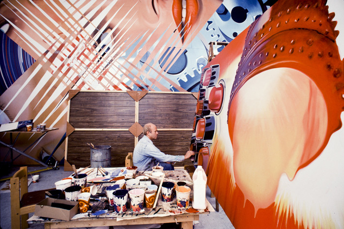 """BOB ADELMAN (1930-2016) James Rosenquist in his studio working on the painting, """"Fahrenheit 1982 Degrees."""" In the background, """"Four New Clear Women.""""  photograph 1981 [printed later] archival pigment print, 1/20, signed  Paper Size: 22 x 14.5 inches 