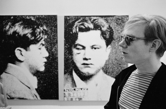 """BOB ADELMAN (1930-2016) Andy Warhol with """"Most Wanted Man No. 2, John Victor G."""" photograph 1965 [printed later] archival pigment print, AP, signed Paper Size: 13.75 x 22 inches 