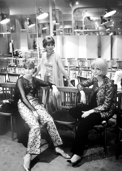Catherine Deneuve and Chanel Models, House of Chanel, rue Cambon, Paris Photograph circa 1962-69 (printed later) gelatin silver print, AP, signed Image Size: 14.5 x 9.5 inches   36.8 x 24.1 cm Paper Size: 16 x 12 inches   40.6 x 30.5 cm  Photograph by Hatami (1928-2017)