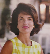 Color portrait of Jackie Kennedy in a checkered white and yellow dress