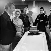 """Photograph by Hatami (1928-2017) Director Peter Yates, Steve McQueen and crew discussing a scene, on the set of """"Bullitt""""  photograph 1968 vintage gelatin silver print, signed, stamped 8.25 x 11.5 inches"""