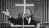 BOB ADELMAN (1931-2016) During a mass meeting photo 1963 [printed later]  gelatin silver print, edition of 15, signed, numbered  paper size > 16 x 20 inches