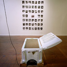 """Nobuho Nagasawa Cowboy's Dream, 1992 refridgerator, earth, motor, speakers, and 47 photographs  From """"The Atomic Cowboy: The Daze After,"""" Daniel Saxon Gallery, Los Angeles, California, 1992"""