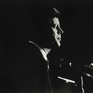 Jacques Lowe (1930-2001)  Senator Kennedy addressing the combined Massachusetts-Texas caucuses  photo 1960 [printed later]  gelatin silver print, signed  paper size > 20 x 16 inches