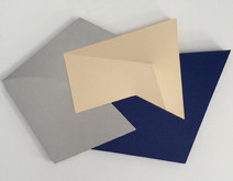 Tridimensional painting looking like a bas-relief, with gray, beige and navy-blue surfaces