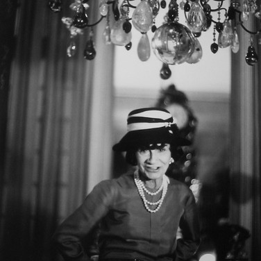 Coco Chanel in her private apartment, House of Chanel, rue Cambon  photo circa 1960s (printed later)  gelatin silver print, AP, signed  image size > 14.25 x 9.5 inches  Photograph by Hatami (1928-2017)