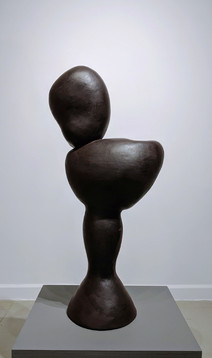 """Dark brown abstract sculpture in terra cotta of amorphous shapes stacked vertically, """"Bust,"""" 1992"""