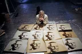 Bob Adelman (1930-2016) Andy Warhol at the Factory with artwork from the suite 'An American Man,' a portrait of Watson Powell, Sr., the founder of American Republic Insurance Company photograph 1965 (printed later) archival pigment print, AP, signed paper size > 12.25 x 19 inches