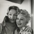 Roy Schatt [1909-2002]  Marlene Dietrich with Eva Gabor  [photograph circa 1950s] [printed later] gelatin silver print, stamped  size > 8 x 9.75 inches  © Estate of Roy Schatt